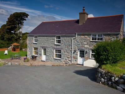 Photo for Set on farmland less than 5 miles from the coast at Criccieth, this traditional farmhouse with spaci