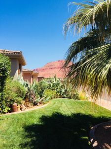 Photo for Quaint private courtyard cottage / casita with stunning views of red mountain.