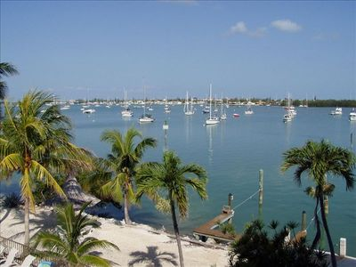 DIRECT WATERFRONT -w/WRAP AROUND BALCONY.-POOL,BOAT SLIP, RAMP - GREAT SUNSETS