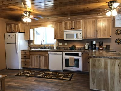 Appliances include fridge with ice maker, dishwasher, oven, microwave, coffee maker, all kitchen essentials for making your meals(pots, pans, dishes)