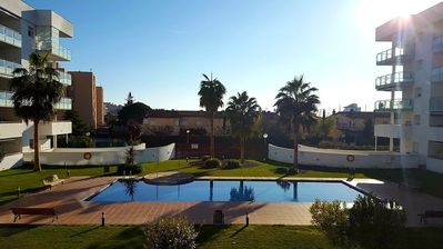 Photo for Penthouse-roof terrace -solarium of 60m2- wifi -parking int-pool-airco