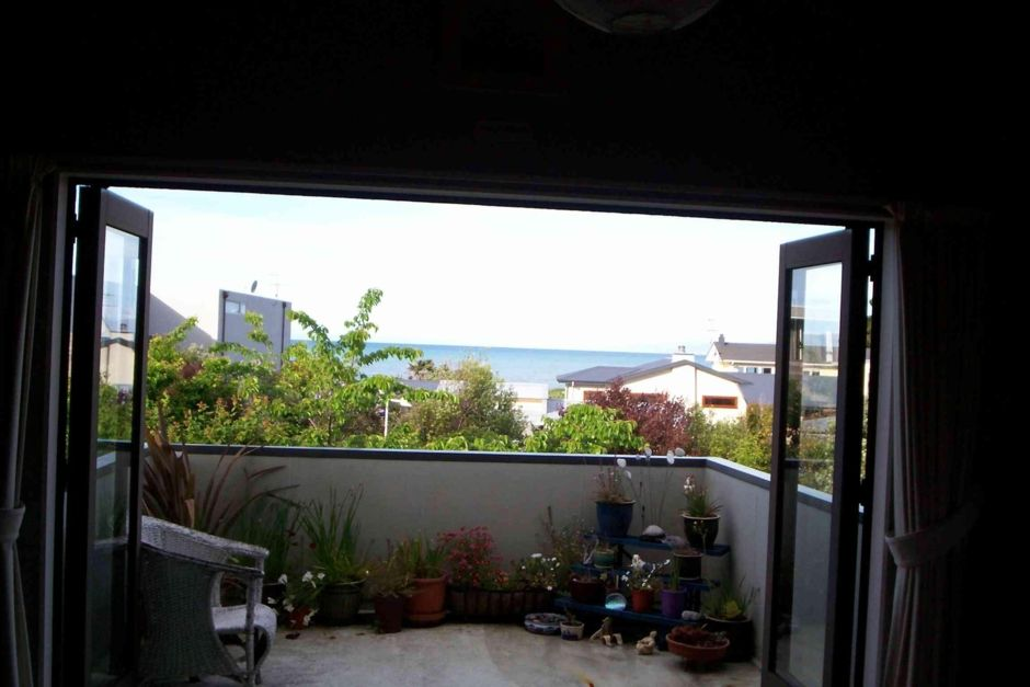 Sunny ,fully fenced 5 mins walk from the beach