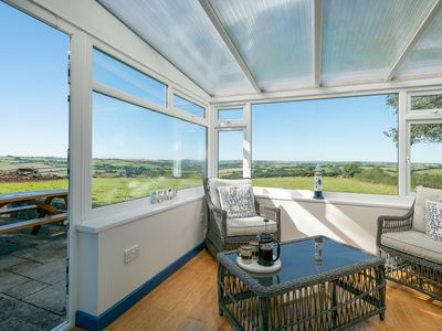Photo for Detached bungalow with stunning views, enclosed garden & a stroll to the pub!