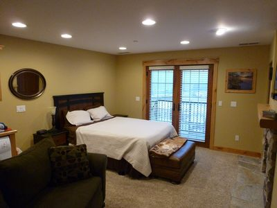 Queen bed close to patio view.