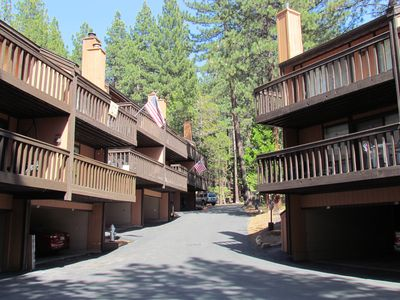 A view of the driveway leading to the units.