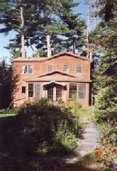 Back of the house with gardens and walkway.