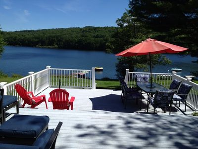 Large walk out deck with steps to  lawn for playing games and the lake.