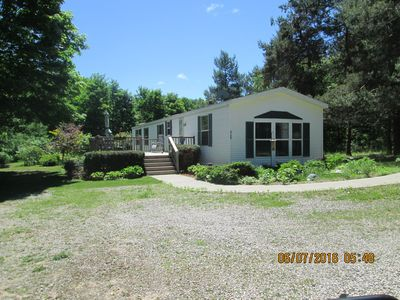 Photo for Beautiful and clean mobile home.Enjoy beautiful Torch Lake, boating,  fishing,xx