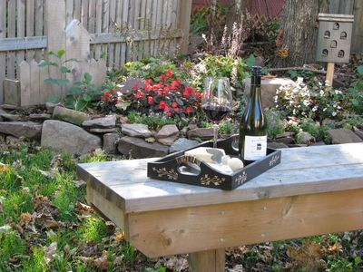 Enjoy some wine and cheese in landscaped yard