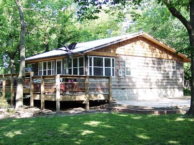Relax at the rustic cedar cabin on the Indianola waterway.