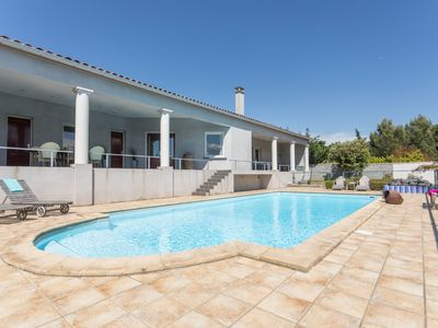 Photo for Modern villa with heated and fenced private pool, enclosed garden, on a river