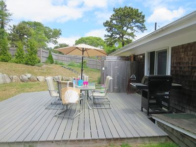 Backyard with dining table, gas grill, and outdoor shower - 26 Ridgevale Road South Harwich Cape Cod New England Vacation Rentals