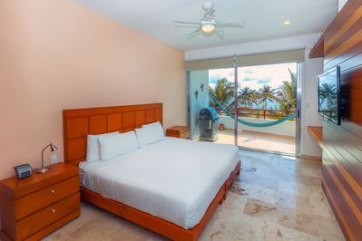 Master suite with ocean view and flat screen HDTV
