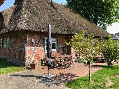 Photo for Charming historic thatched cottage near Lübeck and Baltic Sea