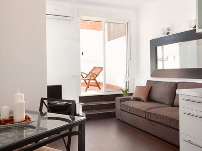 Photo for Bright classic penthouse with terrace by Sagrada Familia with free wifi