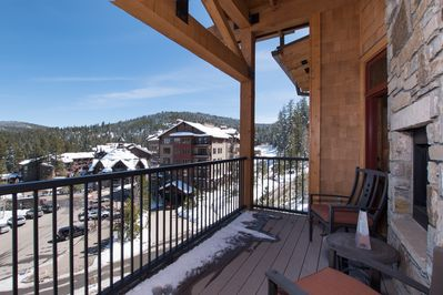 Sierra Range Luxury Condo at Northstar Lodge - a SkyRun North Tahoe Property - Covered Balcony with Fireplace - Located on the 4th floor, take in the stunning views of the Northstar Resort and Village and views of the Sierra Range mountains.