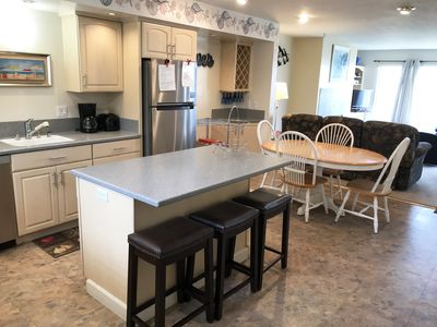 Updated kitchen island with ample seating.