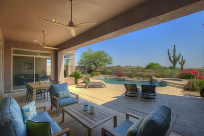 Privacy!! Enjoy the covered patio with panoramic South Views.