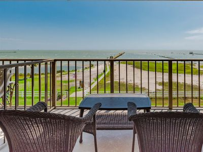 Photo for Panoramic Views! 4th floor balcony overlooks the the lagoon and Aransas Bay!