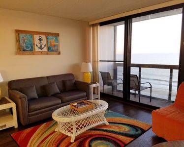 Photo for OCEANFRONT - New Owners - Family Friendly Condo Steps from the Beach!