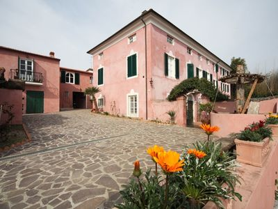 Photo for Apartment with WIFI, pool, A/C, TV, patio, pets allowed, panoramic view, parking, close to Viareggio