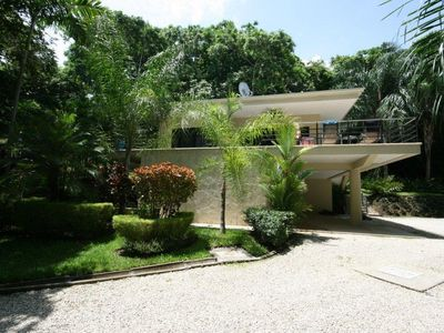 Photo for Private Pool, Secluded New Home with beautiful Gardens, Walk to Guiones Beach