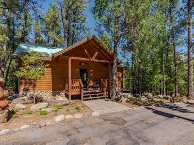 "Photo for ""Spurs and Lace"" cabin with indoor jacuzzi- a perfect romantic getaway for 2!"