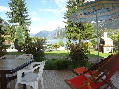 Photo for DIRECTLY ON THE LAKE, fantastic view, quiet, pool, garden and covered terrace