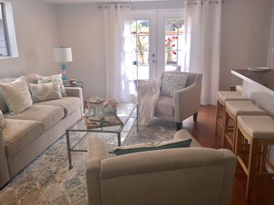 living area with flat screen TV and Queen sleeper sofa