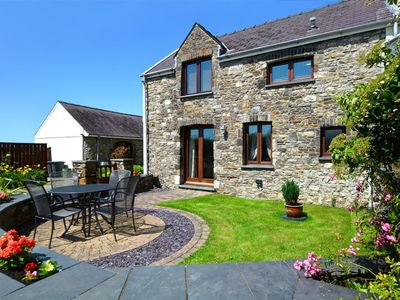 Photo for Featuring a contemporary first floor living space with lovely rural views, this stone barn conversio