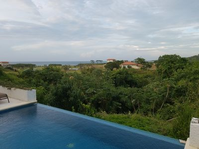 Photo for Villa 1319: Hill top view of paradise at Pristine Bay