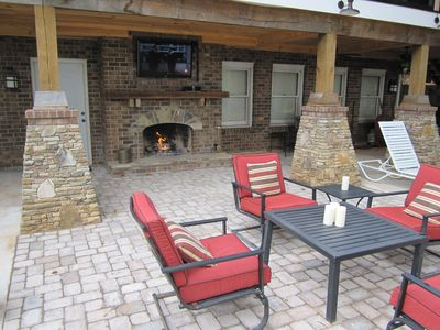 Outdoor fireplace and TV overlooking beautiful Lake Hartwell