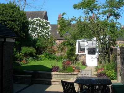 Photo for Garden Cottage is a listed, small town house on one of the loveliest streets.