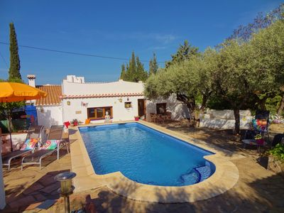 Photo for Delightful holiday villa with 2000 m2 garden and swimming pool within walking distance of the village.