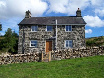 Photo for Located on Cadair Idris mountain, this attractive farmhouse offers excellent views and well-fitted a
