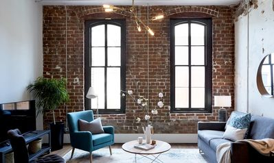 Enjoy exposed brick walls and tall ceilings.