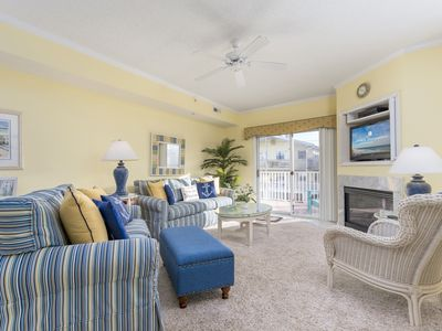 Photo for Spacious 3 bedroom condo with a pool, 1/2 block to the beach!