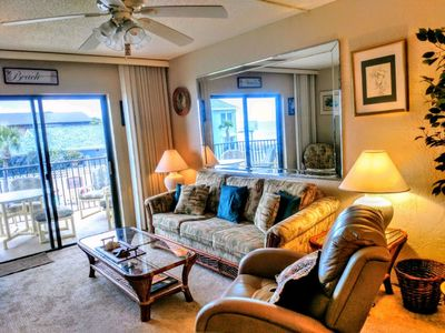 Photo for Comfortable and quaint with view of pool and ocean.