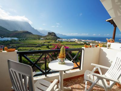 Photo for Apartment with colorful décor and great views of valley and sea