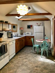 Kitchen/Entry w/ vaulted ceiling and skylight