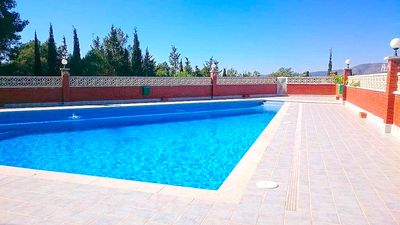 Photo for Bright renovated apartment with views of the vineyards and sea plus pool