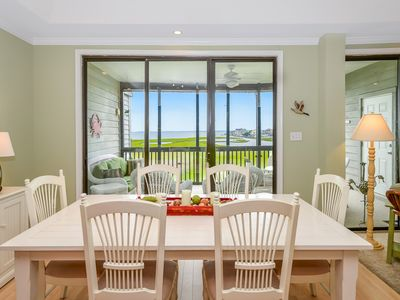 Photo for Furnished with fabulous coastal decor, this 2 bedroom condo features free WiFi, outdoor/kiddie pools, and a direct bay view located uptown on the bayside!