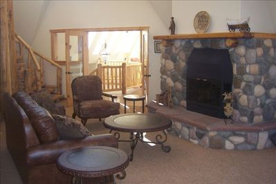 Spacious main living room with kitchen bar, dining room and deck. Beautiful