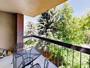 Balcony - Enjoy lovely wood-lined views from the privacy of your covered balcony.