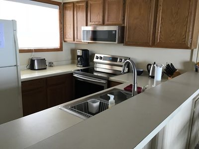 Kitchen with new range and microwave