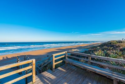 Condo association deck and stairway to nearly private beach!!