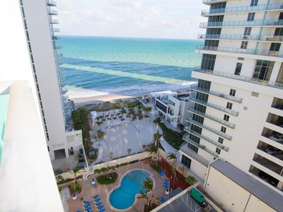 Photo for Hollywood Florida ocean view sian building pool gym parking access to the beach