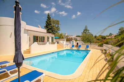 Swimming Pool Area With Babeque,  Sun Loungers, Shades and Shower Area.