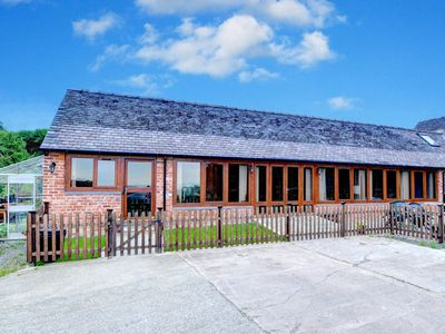 Photo for Former farmhouse with high ceiling, authentic wooden beams and a breakfast bar