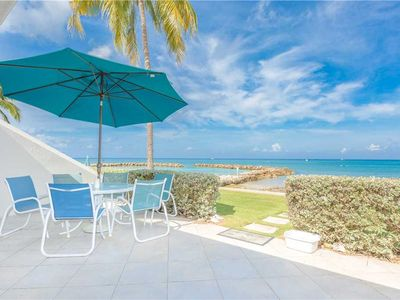 Photo for You could be relaxing in tropical paradise on this Sunset Cove patio only 50 feet from water's edge!